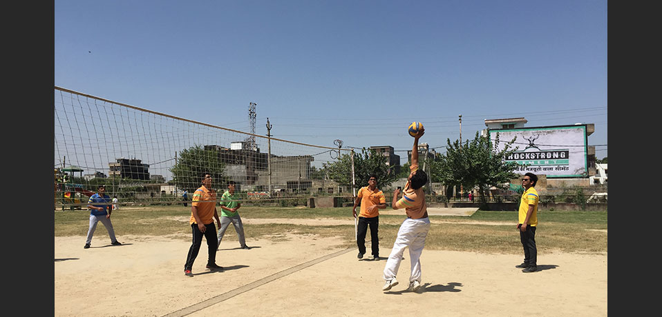 best school for sports in delhi,the image shows student playing volleyball