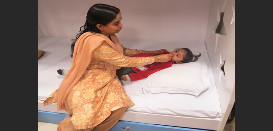 health checkup in school, the image shows a primary wing student lying on bed in medical room
