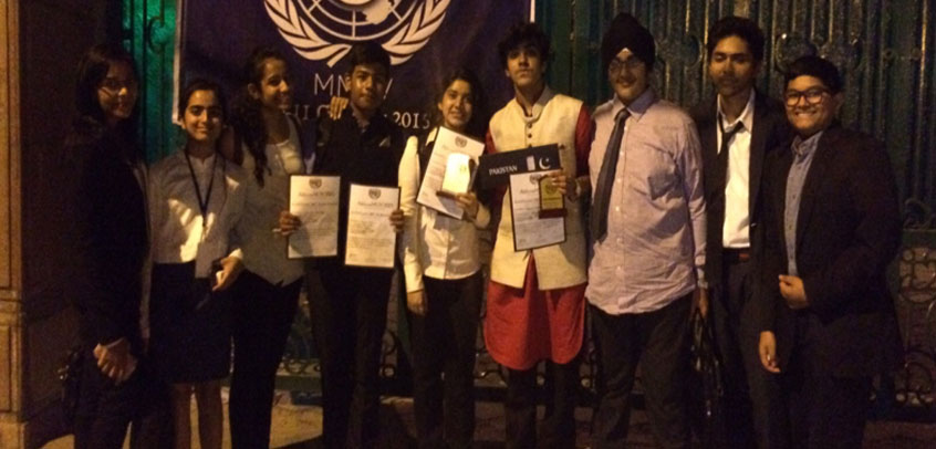 best private school in rohini,students of senior wing holding achievement certificates