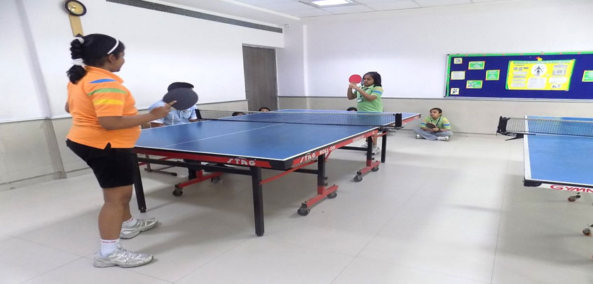 image shows the girl students playing table tennis,best school for sports in delhi