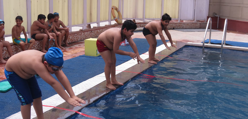 image shows the students of school enjoying their swimming class,best school in sports