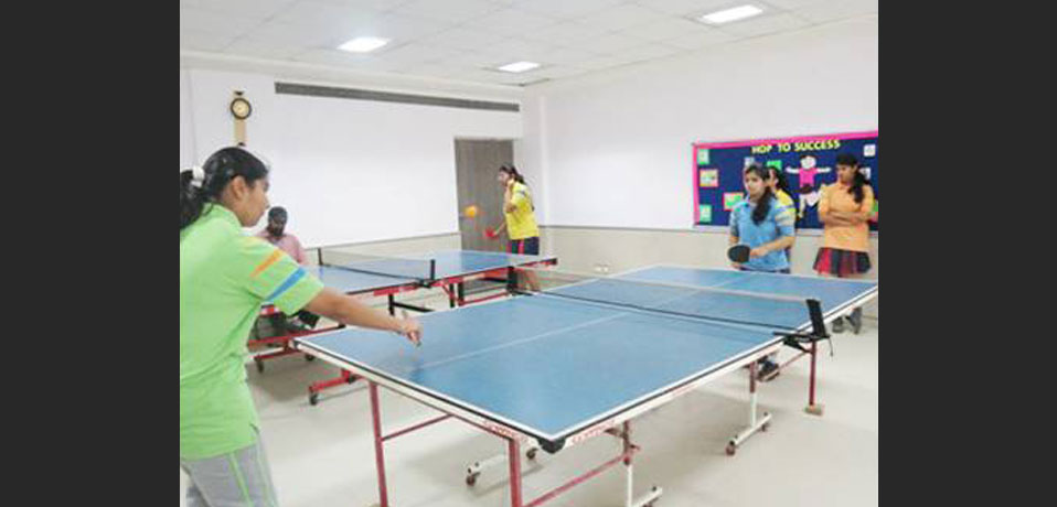 the image shows team of girl studnets playing table tennies, school best in indoor games