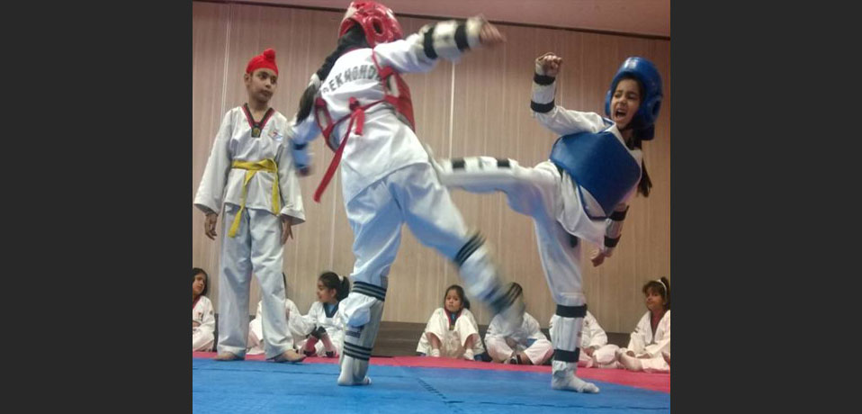 image shows students of junior wing are practising taekwondo,best sports school in delhi