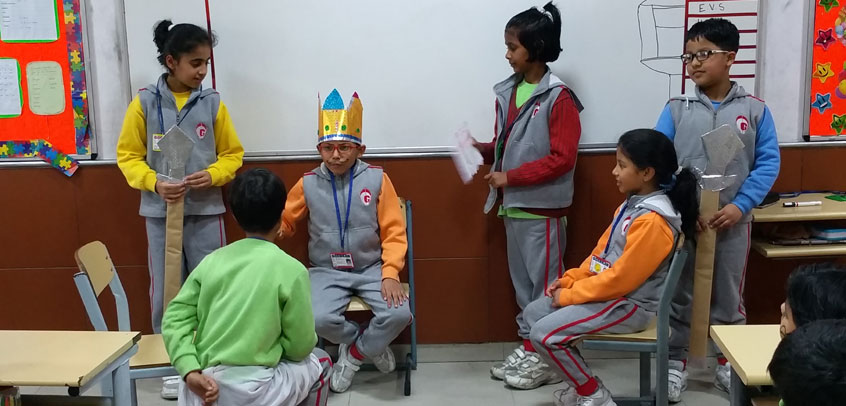 school with theatre in rohini,students are performing a play in classroom