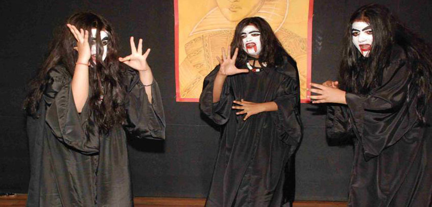 school with theatre in delhi, students performing horror play in school theatre