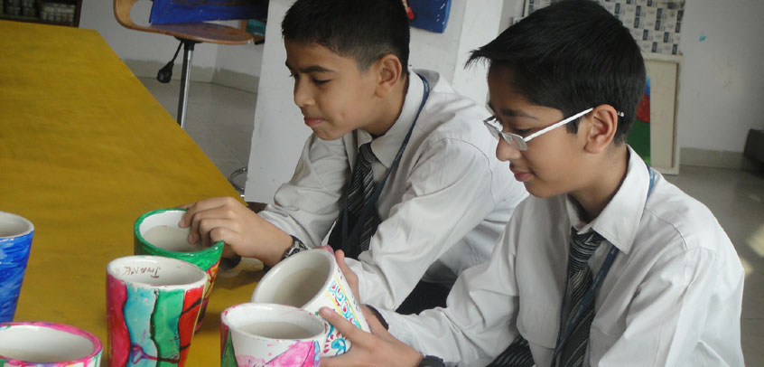 school best in extra curricular activities,teacher and student enjoying pottery class