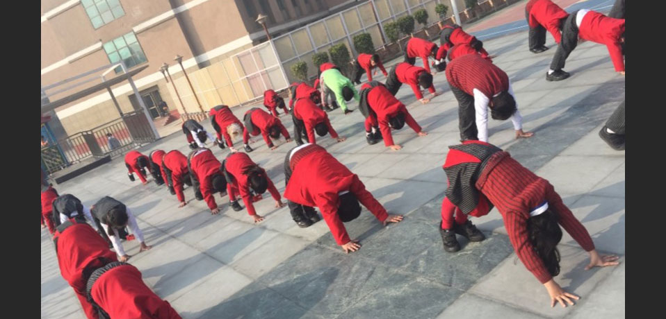 the image shows the students of gd goenka doing yoga in school campus,yoga in school